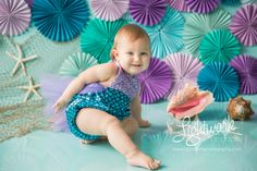 Mermaid 1st Birthday Cake Smash Photo and Props by Lightwork Photography, teal, turquoise, purple, lavender, fish netting, paper fans, rosettes, pinwheels, outfit from ShopBelleThreads on etsy.com