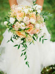 Lush and organic wedding bouquet in peach, white and green @weddingchicks