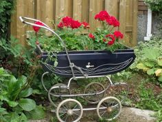 New life for a vintage baby carriage.  I think I'd add some baby's breath to it too!