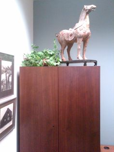 Reproduction cast iron horse looks very stately indeed in this office setting.  Linda Zoffer of Del ZIO Designs, a happy Antiques by Zaar Customer since April 2009!