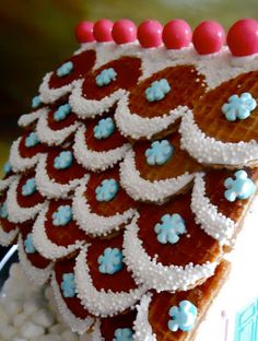 Love this style of gingerbread house roof! The icing and the sprinkles, the little waffle cookies as shingles... perfect!