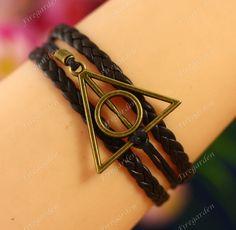 harry potter Bracelet---antique bronze Deathly Hallows & imitation leather Bracelet. $3.99, via Etsy.