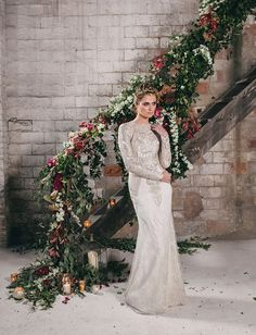 Industrial Wedding Inspiration in a Former Factory  Decorate your banister in faux flowers from http://www.afloral.com/  #fauxflowers