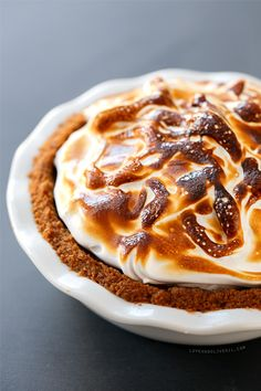 Smores Pumpkin Pie - a twist on a Thanksgiving favorite with a hidden layer of chocolate ganache and a mound of fluffy, toasted marshmallow on top.