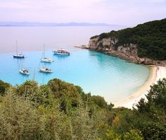 Voutoumi, Anti Paxos, Greece Voutoumi beach on Anti Paxos is the smallest of the Ionian Islands. To get to the remote crescent of white sand surrounded by steep cliffs, take a short boat ride from Paxos Island. Beautiful Islands, Beautiful Beaches, Paxos Greece, Paxos Island, Sailing Trips, Voyage Europe, Island Beach, Small Island, Greek Islands