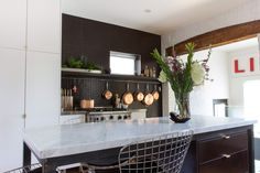 Love this kitchen. especially the exposed wood beam, mix of black and white, and island. Kitchen Dinning, Kitchen And Bath, Toronto Island, Minimalist Chic, Island Design, Exposed Beams, Wood Beams, Decoration, Backsplash