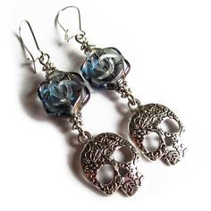These beautiful skull and rose earrings are made of rose shaped Czech vintage style glass bead and great quality ornamental skull charm. They also have silver colored nickel free kidney earring wires.  The rose has a violet colored coating on top, visible in different angles. Otherwise the glass is violet with grey and blue tones.  Length of the dangling earring without the hook is about 48mm.