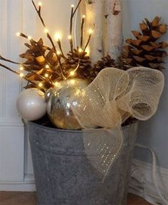I like this idea of basket with a scented candle,  a batch of chocolate candy cane cookies, an ornament, some cinnamon sticks and pine cones to make the basket smell like xmas when u open it