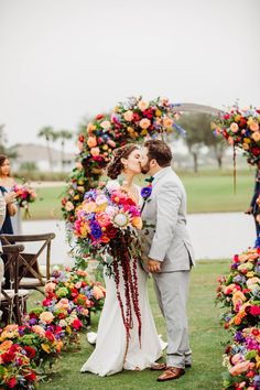 Summer Wedding Ceremony with colorful aisle and round floral arch | Bride and groom kissing photo - Bohemian Road Photography | Colorful Wedding Flowers Pop Agains Teal Bridesmaid Dresses Floral Wedding, Wedding Colors, Wedding Bouquets, Wedding Flowers, Wedding Ceremony, Our Wedding, Dream Wedding, Teal Bridesmaid Dresses, Bride And Groom Pictures