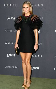 GWYNETH PALTROW in a Gucci LBD featuring multicolor sequin tulle sleeves, plus a black clutch and gold peep-toe sandals at the LACMA Art + Film Gala in L.A.