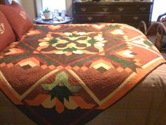 Pushing Up Daisys pattern by Pam Bono.  Free motion quilting on domestic.
