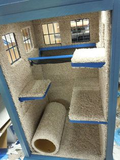 Fletcher would love this!! Turn an old   cabinet into a private kitty playhouse (especially for families with dogs for   private area). Cover in carpet and place sleeping and jumping areas.    - this   kind of looks like a tardis to me...