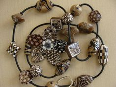 Polymer clay necklace and  flower by LaurelTreeStudio on Etsy,