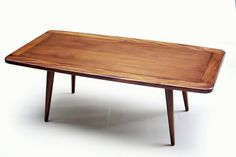 "Blue Ocean Traders: Moda Coffee Table. Mahogany mid-century style coffee table. Measures 47"" x 24"" x 17"""
