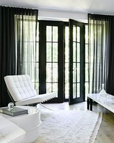 Black and white are a perfectly dramatic duo. Get the look at theshadestore.com // Designed by Yvonne Ferris Interiors // Photo by Nancy Elizabeth Hill Door Coverings, Woven Wood Shades, Solar Shades, Living Room Windows, Interior Photo, Patio Doors, Window Treatments, House Design, Swatch