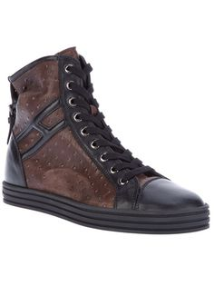 Brown ostrich skin effect leather hi-top from Hogan Rebel featuring a black leather toe cap, a black rubber sole, a black leather signature logo at the outside ankle, an embossed signature logo at the back of the heel, a strap and buckle detail at the rear, and a front lace-up fastening.