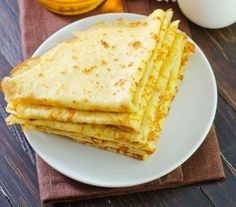 Ciasto na naleśniki - Przepisy - Magda Gessler - Smaki Życia // Crepe batter recipe: 1 & 1/4 cups milk, 1 & 1/4 cups water, 2 eggs, 1 & 2/3 cups flour, pinch of salt. Beat eggs with a pinch of salt. Add flour, milk, and water and mix well. Batter should flow off mixing spoon while simultaneously coating it. Fry on a butter-greased frying pan. Substituting water for seltzer water will make fluffier batter.