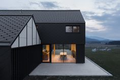 Built by SoNo Arhitekti in , Slovenia with date 2015. Images by Žiga Lovšin. Exterior  One-family villa M is located in an area, which represents a typical Slovenian landscape. That is why the d...