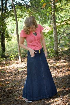 Long denim skirt with feminine pink top.