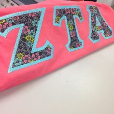 It's time for the pattern of the day!  Check out this lovely pattern! If you see something you like give us a call at 1-800-247-3352 or shop our online gallery! #somethinggreek #sororitylife #zetataualpha #glitteraquaborder #ig10516