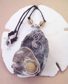Oyster shells and quartz necklace. by regiooaksartist on Etsy, $15.00