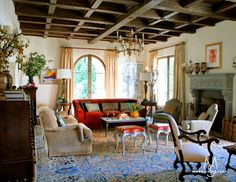 Spanish Revival INTERIOR – LIVING ROOM The living room palette was inspired by an antique Baktiari carpet and the room is anchored by a century Italian fireplace. Spanish Revival, Spanish Style Homes, Spanish House, Spanish Colonial Decor, French Colonial, Colonial Cottage, Spanish Interior, Modern Colonial, Country French