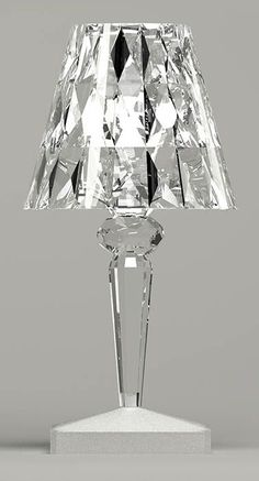"""The Battery LED Table Lamp was designed by Ferruccio Laviani for the Kartell brand. Kartell is a major global representative of the """"Made in Italy"""" label. Silver Wallpaper, Lamp Design, Lamp, Silver Chandelier, Silver Tile, Kartell, Lamp Light, Lights, Silver Candle"""
