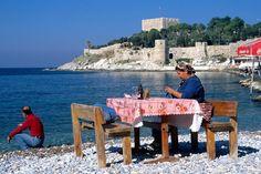 Knitting on beach, Turkey