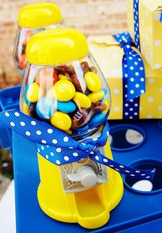 Probably not the gumball machine.... but maybe the blue and yellow candies?