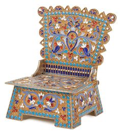 A RUSSIAN SILVER-GILT & CLOISONNE ENAMELED SALT CHAIR, Gustav Klingert. Overall enameled in scrolling foliage on a stippled gilt ground with blue beaded enamel borders. The hinged seat opening to reveal a gilded interior salt reservoir. Hallmarked Moscow, 84 standard, dated 1893, and stamped KLINGERT. - Jackson's International Auctioneers and Appraisers