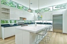 see-through backsplash using custom windows from Fleetwood USA during a complete remodel of a 1980s home.