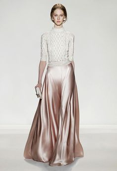 Pair a cable-knit sweater with a silky skirt for a luxe winter wedding look | Brides.com
