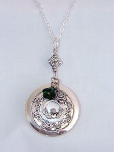 Silver Irish Locket,Claddagh Locket Engraved Locket,Locket,Photo Locket,Locket Necklace,Wedding Necklace, Personalized Jewelry. $25.00, via Etsy.