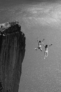 Two cliff jumping girls.