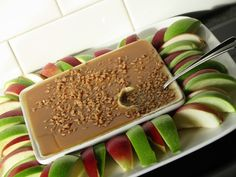 : Caramel Apple Dip1 - 8 oz. package of cream cheese, softened 1/4 cup brown sugar 1 cup caramel topping (small jar sundae topping) 1 package Skor bits (or chopped Skor bars)  4-6 apples (Granny Smith or your favorite) Mix cream cheese and brown sugar until blended. Spread in pie plate or large glass serving plate. Chill for one hour. Spread caramel topping over cream cheese mixture. Sprinkle with Skor bits...sparingly or use the entire package!  Slice apples and arrange around dip.
