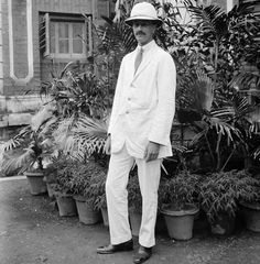 The photos are said to have been taken in the country at the time of the British Raj and it is thought the negatives were untouched for almost 100 years. An unknown man posing for a photograph in a white linen suit Picture: RCAHMS/PA