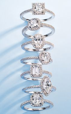 These decadent engagement rings showcase a diamond laden shank and halo surrounding the diamond shape of your choice.