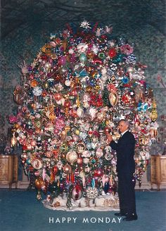 Silent movie producer Harold Lloyd. Seen here in 1971 while tending to his year round Christmas tree display, the story of his collection, his home, and his personal history are utterly fascinating.