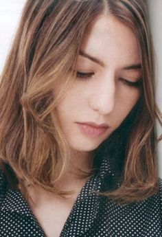 Sofia Coppola. Lip color, absence of eyeshadow, clear skin