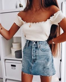 Cute white off the shoulder top with denim mini skirt.