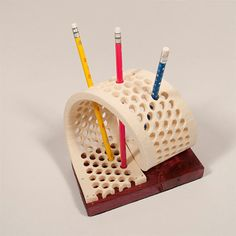 The Felt Pencil/Pen Holder is truly a unique work of art! Made from high quality varnished wood and remnant felt, this Pencil/Pen Holder makes any desk, office or cubicle look one of a kind. Simply slip any average pen through the holes in the felt, and create your own design! Approximately 3.5 inches (8.9cm) high, with a base measuring 3.5 inches (8.9cm) wide x 6.5 inches (16.5cm) long.  *Please note that this listing is for the Felt Pencil/Pen Holder only, and does not includ...