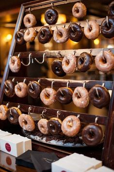 dessert bar with different kinds of donuts #weddings #cakes #donuts #weddingreceptions #weddingideas ❤️ http://www.rosesandrings.com/wedding-donut-bar-ideas/