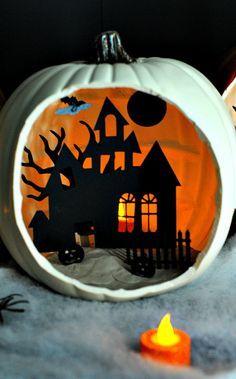 Love the look of this DIY shadowbox Halloween pumpkin diorama.