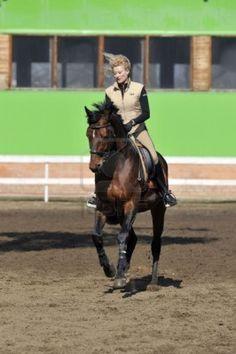 Equestrian sport: a female caucasian horse rider riding her beautiful brown horse