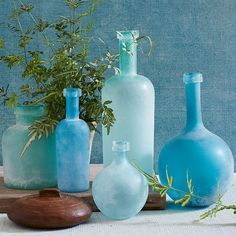 Using a special salt blast technique, these textured matte Waterscape Vases have the look and feel of sea glass that's been weathered by the waves. Group different shades together to create your own sea-inspired vignette.