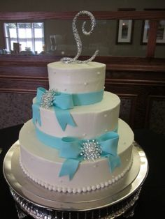 very elegant tiffany blue ribbon wedding cake!    Re-do with one blue bow and one pink bow!