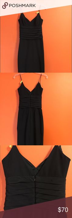 """Black Nicole Miller Evening Gown/ Prom Dress Gorgeous black evening gown/ prom dress in perfect condition. Only worn once. Beautiful v-back with a high slit. I am 5'3"""" and it is the perfect length with 3"""" heels. Recently dry cleaned. Unfortunately, the size on the tag did wear off after dry cleaning but it is a size 2. Feel free to make an offer or inquiry! Nicole Miller Dresses Prom"""