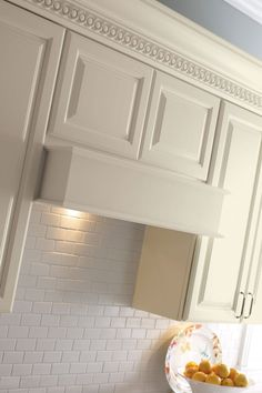 "Canopy wood hoods add a perfect mix of cabinetry style to conceal ventilation in 30"" and 36"" widths - Schrock Cabinetry"