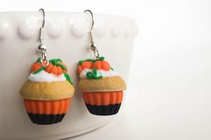 A personal favourite from my Etsy shop https://www.etsy.com/listing/463903434/pumpkins-cupcakes-earrings-halloween