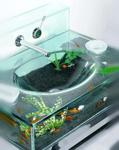 This highly entertaining accessory allows you to enjoy an aquarium or zen garden within your restroom. Stand available in chrome and wenge.Ok not in my house but how cool is that!